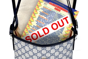 a Gucci bag containing a Glastonbury Festival flyer