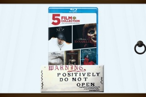 An image of The Conjuring Universe blu-ray locked in a glass case at The Warren's Occult Museum