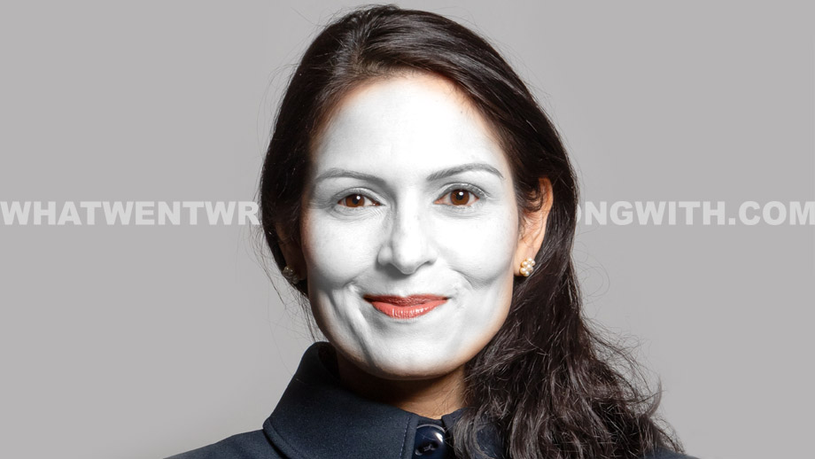 Priti Patel in white face makeup to illustrate that she is a sellout