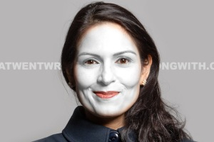 Priti Patel in white face makeup to show that she is a sellout