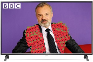 An image of Graham Norton wearing lots of remembrance poppies on his suit on the BBC
